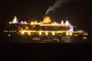 The Queen Mary viewed at night from the balcony of Capeview Apartments